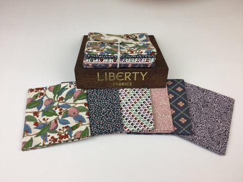 Liberty Fabric 'Summer House' Fabric Fat Quarter Bundle in Pink and Lavender. This bundle has six iconic fabric fat quarters from the Liberty 'Summer House' collection in Pink and Lavender. sold by UK Liberty of London fabric stockist Frills and Froth. seller of designer fabric from Liberty