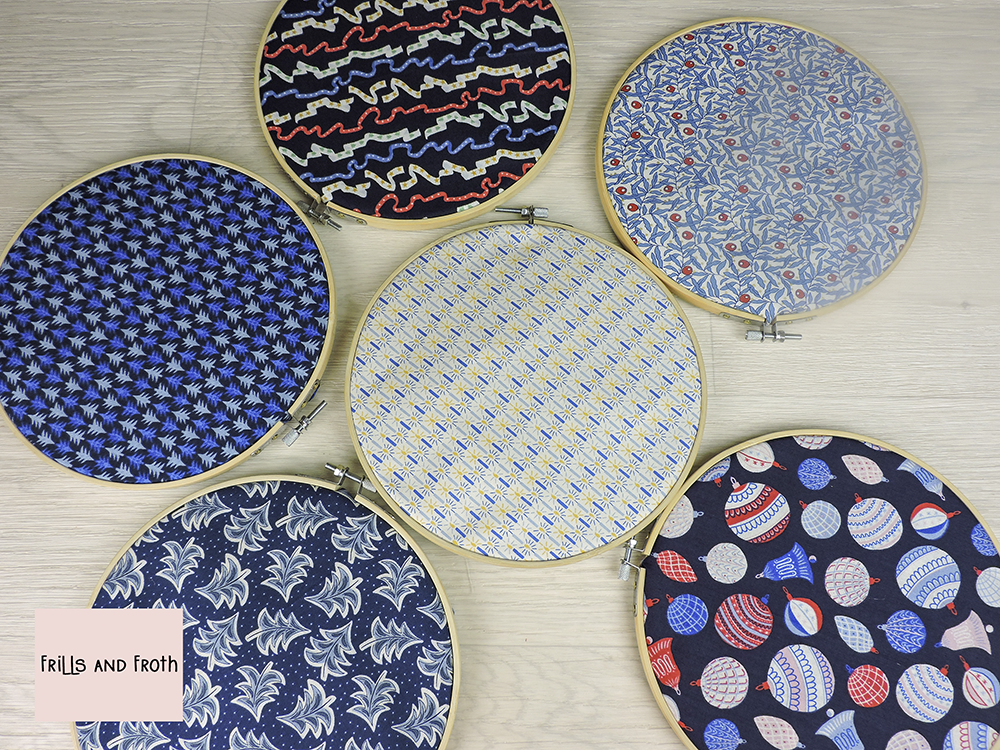Liberty Fabric 'Merry and Bright' Quilting Fabric Fat Quarter Bundle in Blue displayed using embroidery rings.