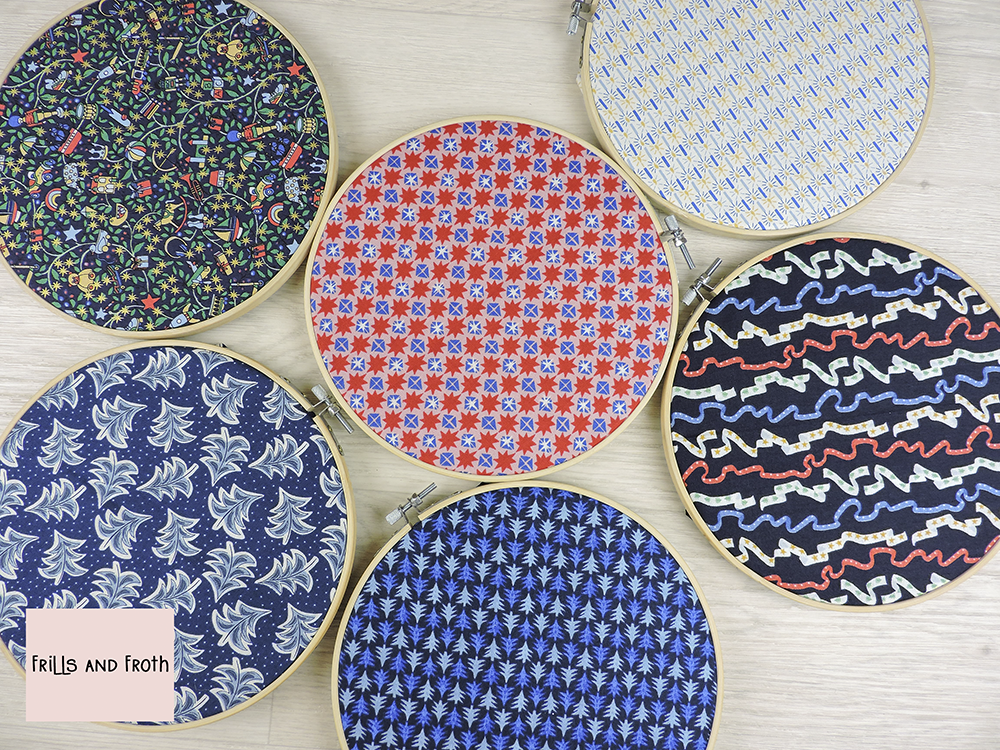 Liberty Merry and Bright Fat Quarter bundle in blue and red. Fabric shown in embroidery rings to better display the fabric.