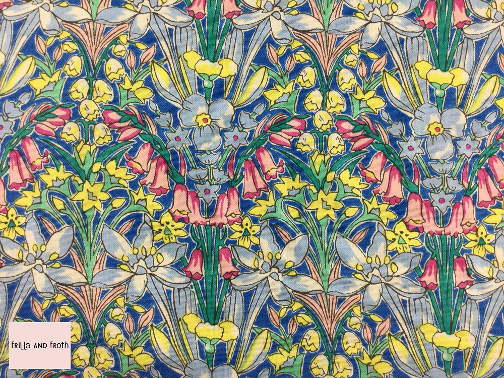 Liberty 'Adlington Hall' fabric from the 'Flower Show Summer' collection features a bold bright floral print.