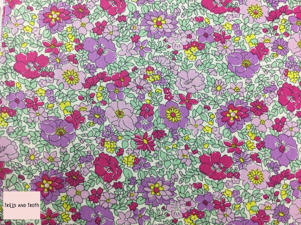 Liberty fabric 'Arley Gardens' quilting fabric Liberty 'Arley Gardens' fabric from the 'Flower Show Summer' collection features a pink and purple floral design.