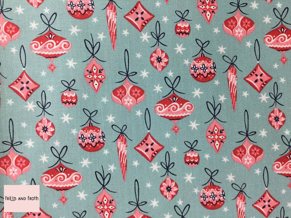 Liberty fabric 'Deck The Halls' in Blue quilting fabric Liberty 'Deck The Halls' fabric from the 'A Festive Collection' features red and white baubles on a Blue background.