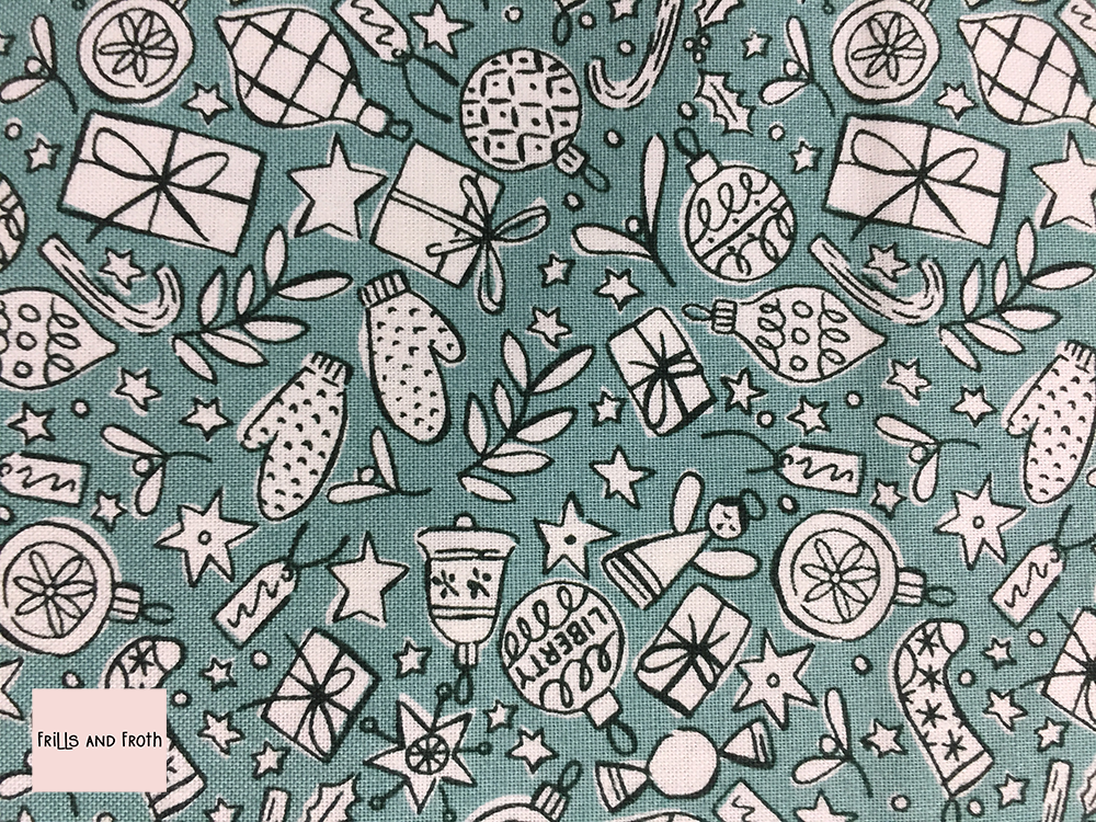 Liberty fabric Festive Cheer in white and green quilting fabric