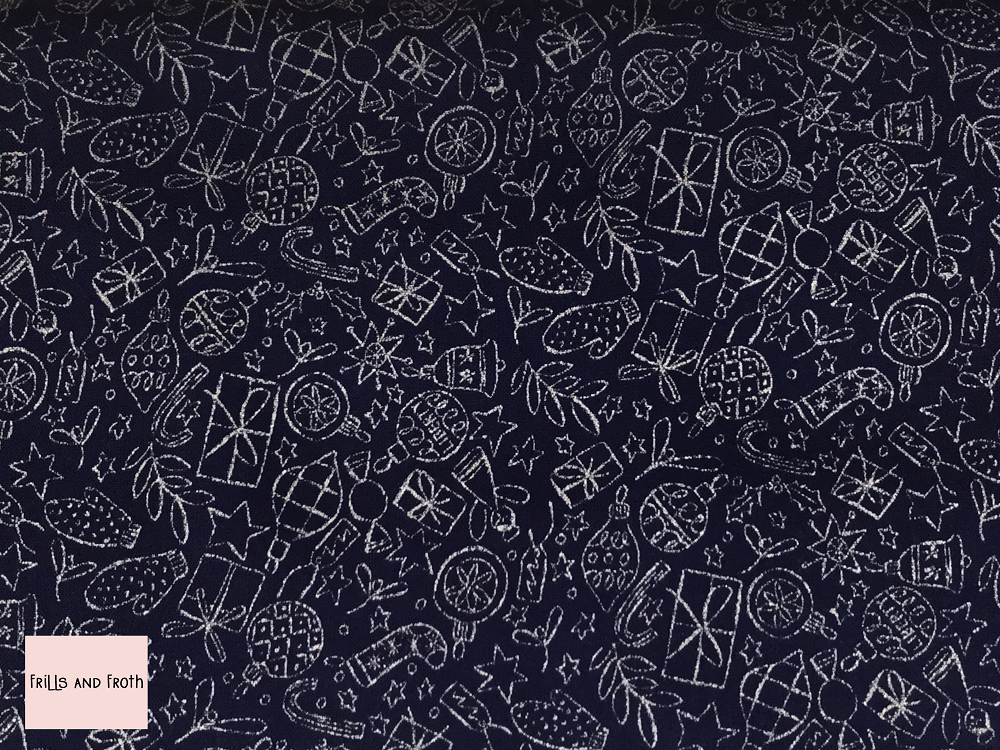 Liberty fabric 'Festive Shine' in Blue & Silver metallic quilting fabric Liberty 'Festive Shine' fabric from the 'A Festive Collection' features a presents, mittens, angels and more in metallic silver on a Blue background.