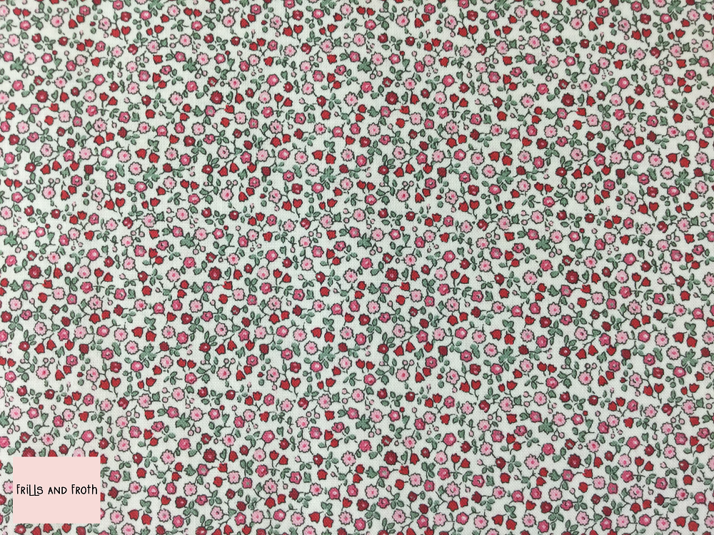 Liberty fabric 'Suffolk Fields' quilting fabric in red Liberty 'Suffolk Fields' fabric from the 'Flower Show Winter' collection features a red and green floral design.