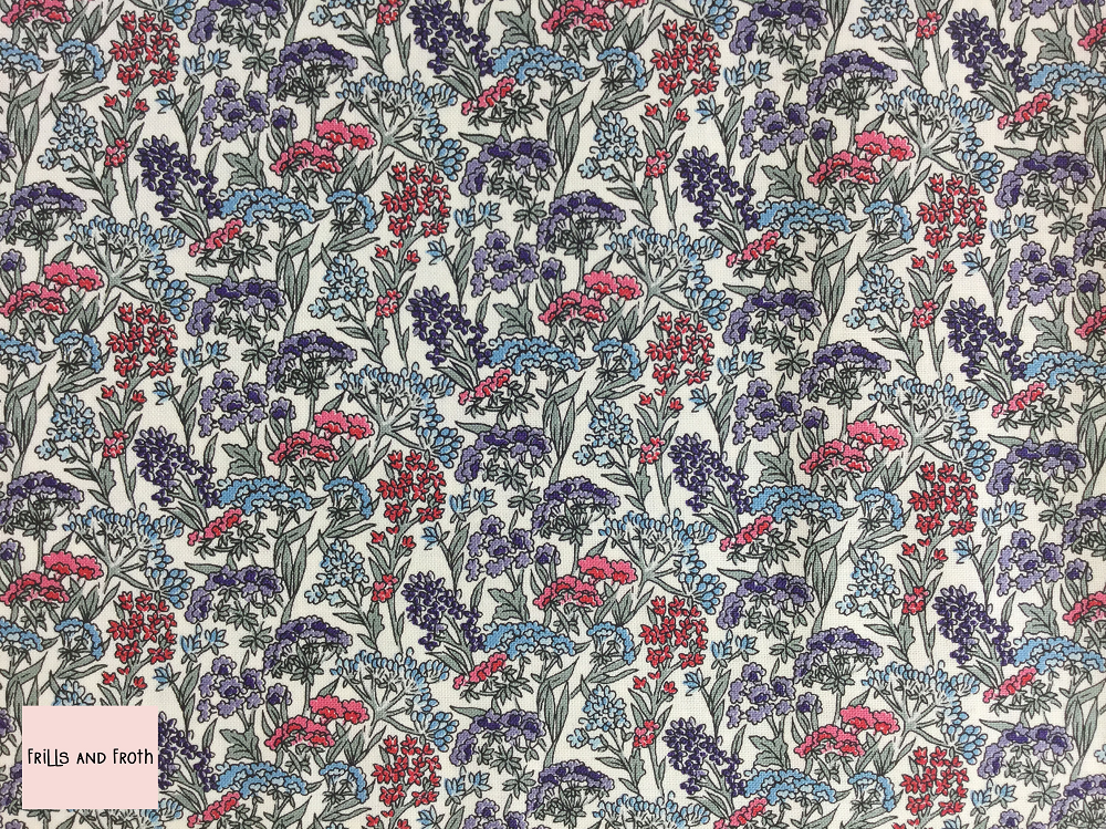 Liberty fabric 'Yorkshire Meadow' quilting fabric Liberty 'Yorkshire Meadow' fabric from the 'Flower Show Winter' collection features a red and blue floral design.