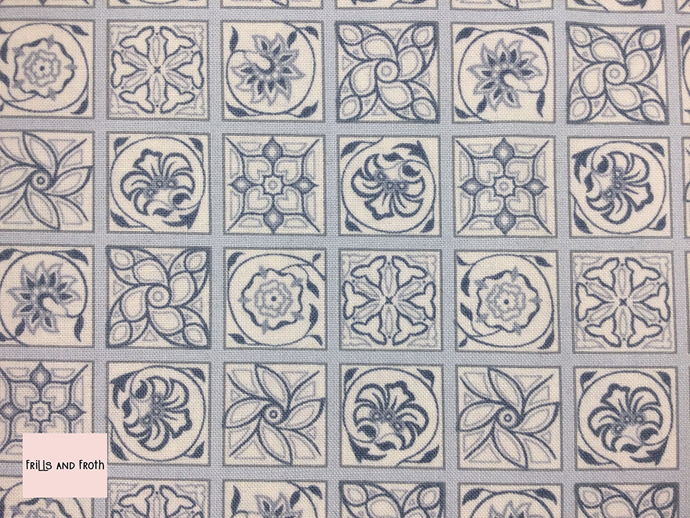 Liberty fabric 'Argyll Tile' quilting fabric Liberty 'Argyll Tile' fabric from the 'Emporium' collection features a monochrome floral tile design.