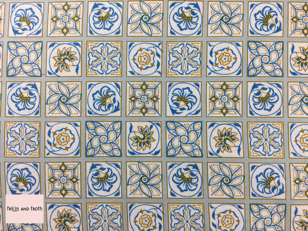 Liberty fabric 'Argyll Tile' quilting fabric Liberty 'Argyll Tile' fabric from the 'Emporium' collection features a blue and yellow floral tile design.