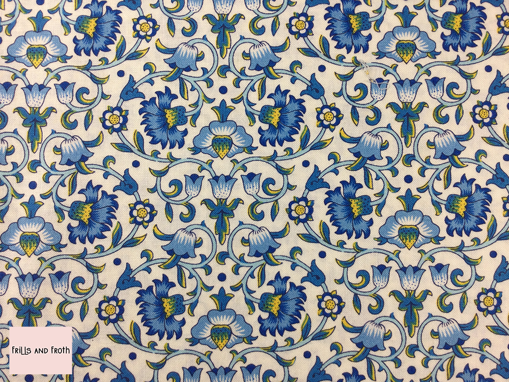 Liberty fabric 'Culodden Vine' quilting fabric Liberty 'Culodden Vine' fabric from the 'Emporium' collection features a blue and yellow floral design.