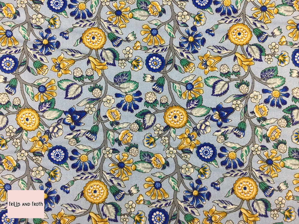 Liberty fabric 'Merchant's Tree' quilting fabric Liberty 'Merchant's Tree' fabric from the 'Emporium' collection features a blue and yellow floral design.