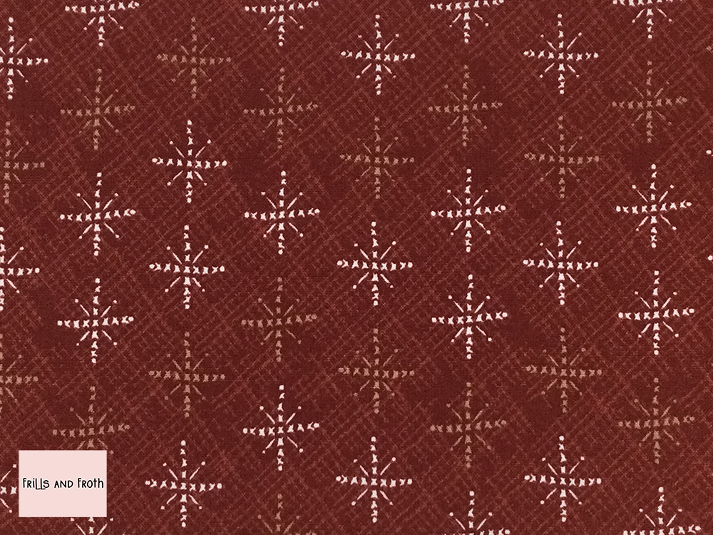 Lynette Anderson fabric 'Snowflakes' quilting fabric in red. Lynette Anderson fabric 'Snowflakes' quilting fabric from the 'Scandinavian Christmas 2' collection features snowflakes on a red fabric.