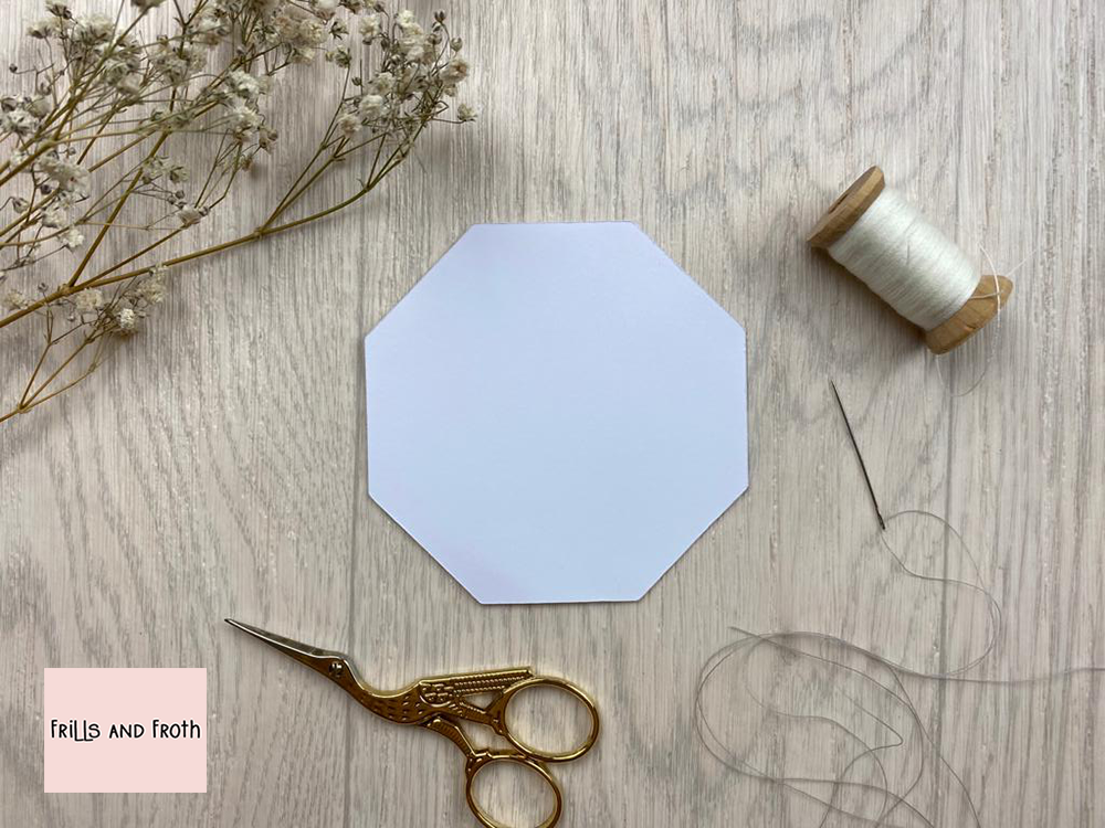 Picture of single Octagon EPP paper, surrounded by sewing notions and flowers. English Paper Piecing Octagon Papers  Our Octagon English paper piecing (or EPP for short) papers are made out of thin flexible card, mechanically cut in house for accuracy.