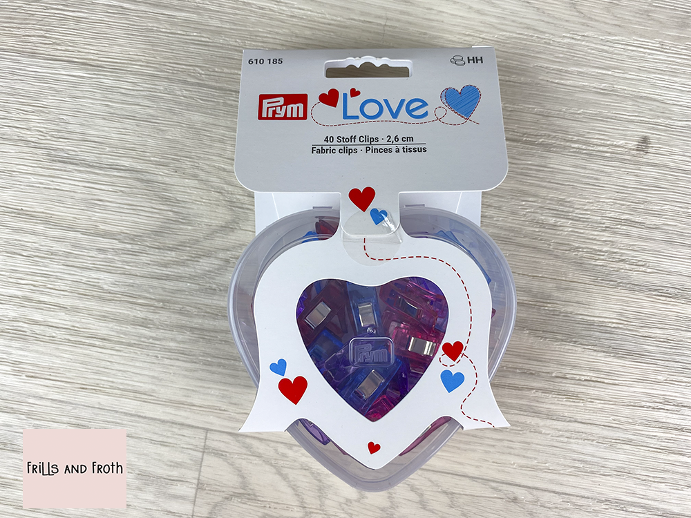 Picture of Prym Love Fabric Clips 2.6cm 40 multi coloured fabric clips in a handy heart shaped container 610185