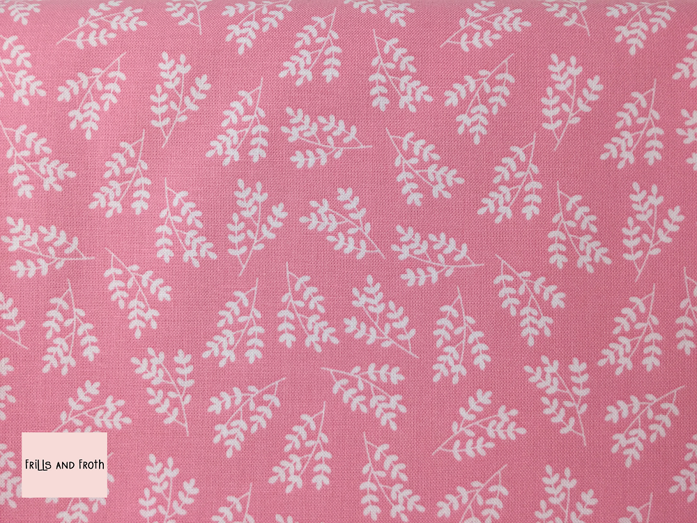 Riley Blake 'Singing in the Rain' 'Stems' in Pink quilting fabric This quilting fabric from the 'Singing in the Rain' collection by Riley Blake features a white leaf print on a pink background.