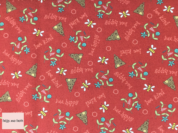 Henry Glass 'All About The Bees' 'Bee Scatter' quilting fabric in Red This quilting fabric from the 'All About the Bees' collection by Henry Glass features bees and hives on red background.