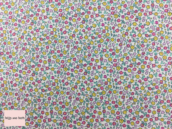 Liberty fabric 'Suffolk Fields' quilting fabric Liberty 'Suffolk Fields' fabric from the 'Flower Show Summer' collection features a pink and yellow floral design