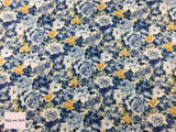 Liberty fabric 'Wild Bloom' quilting fabric Liberty 'Wild Bloom' fabric from the 'Emporium' collection features a blue and yellow floral design.
