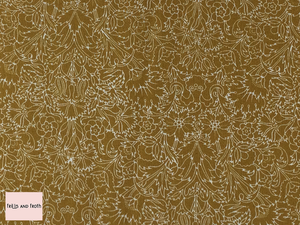 Liberty fabric 'Turner' quilting fabric Liberty 'Turner' fabric from the 'Emporium' collection features a mustard floral design.