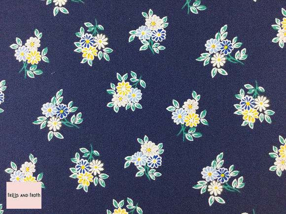 Liberty fabric 'Kyoto Posey' quilting fabric Liberty 'Kyoto Posey' fabric from the 'Emporium' collection features a blue and yellow floral design.