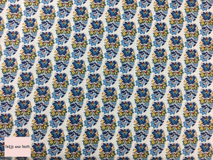 Liberty fabric 'Palmeria' quilting fabric Liberty 'Palmeria' fabric from the 'Emporium' collection features a blue and yellow floral design.