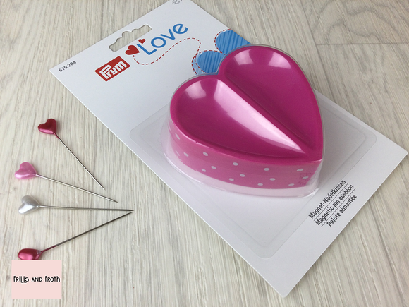 Prym Love Heart Shaped Magnetic Pin Cushion Pink heart shaped polka dot magnetic pin cushion from the Prym Love collection.  This handy item by Prym in pink and white polka dot design, heart shaped and magnetic to keeppins and needles handy while you sew.  Perfect addition to your sewing and quilting essentials.  Prym 610284