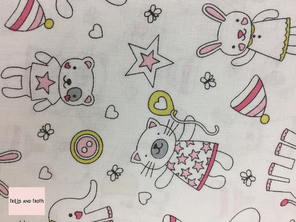 Michael Miller 'Munchkins' in pink on white quilting fabric