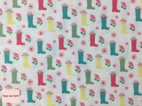 Riley Blake 'Singing in the Rain' 'Boots' in White quilting fabric This quilting fabric from the 'Singing in the Rain' collection by Riley Blake features a multi coloured flower filled wellington boot and flower print on a white background.