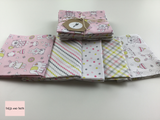 Michael Miller 'Tiny Tots' quilting fat quarter bundle in pink.   This bundle from the 'Tiny Tots' collection by Michael Miller contains five fat quarters in a pink colourway.