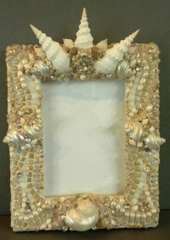 Kismet & seashell frame by Michele Petno