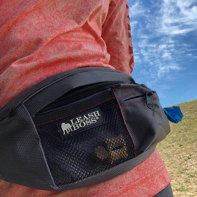 woman wearing dog walking fanny pack