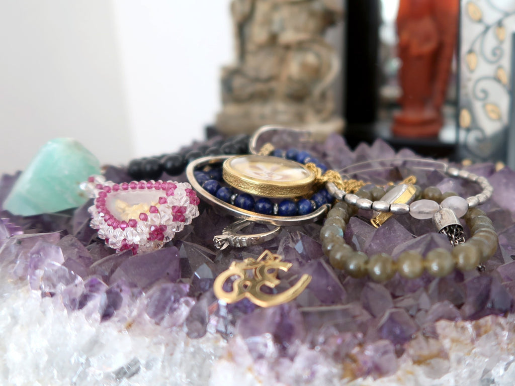 Crystal Healing Jewelry Charging on an Amethyst Geode Cluster @Idigcrystals.com