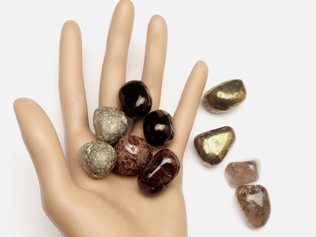 tumbled stones in hand