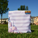 Candy Cove Pirate MinoMonsters Tote Bag in the grass