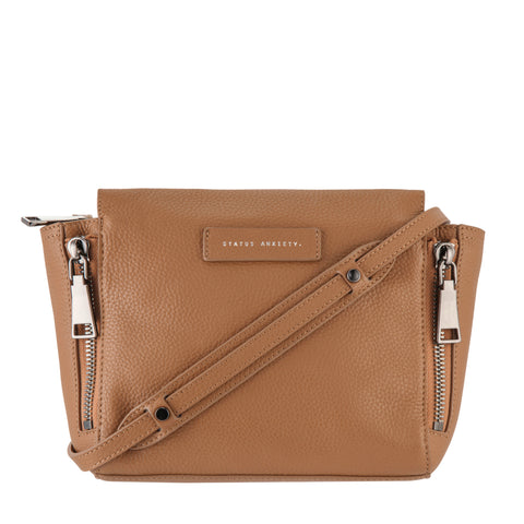 products/status-anxiety-bag-the-ascendants-tan-front-with-strap-wrapped.jpg
