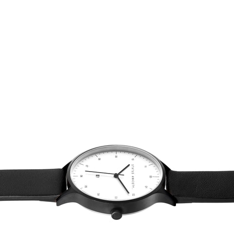 products/status-anxiety-watch-inertia-matte-black-white-face-black-strap-side-angle.jpg