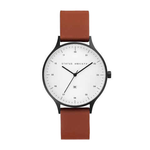 products/status-anxiety-watch-inertia-matte-black-white-face-tan-strap-front.jpg