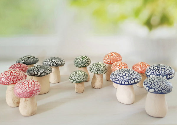 Miniature ceramic mushrooms