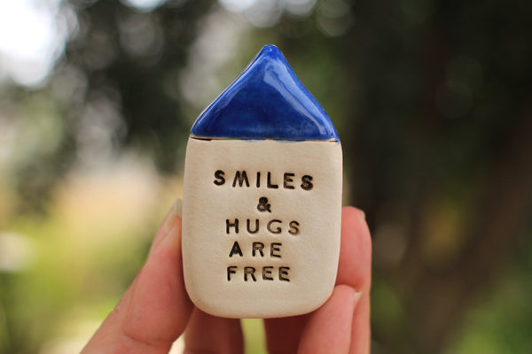 Miniature house Motivational quotes Inspirational quote Smiles & hugs are free