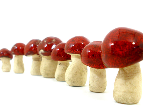 Ceramic red miniature mushrooms in variety of sizes and shapes