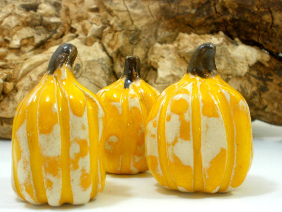 Yellow and white ceramic pumpkins