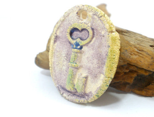 Key pendant A stylish and OOAK ceramic pendant in shades of purple and green