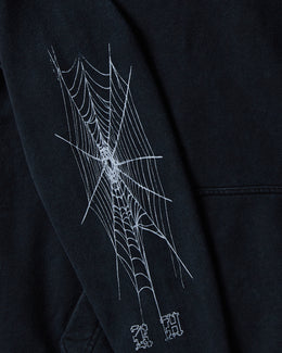 Men's Rhude Paradiso Hoodie in black with spider graphics on the sleeves, a large graphic on the back and front pocket