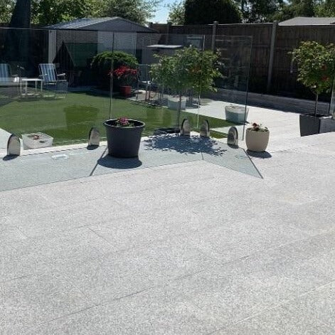 Durero Grey Granite Effect Outdoor Tile in Modern Garden