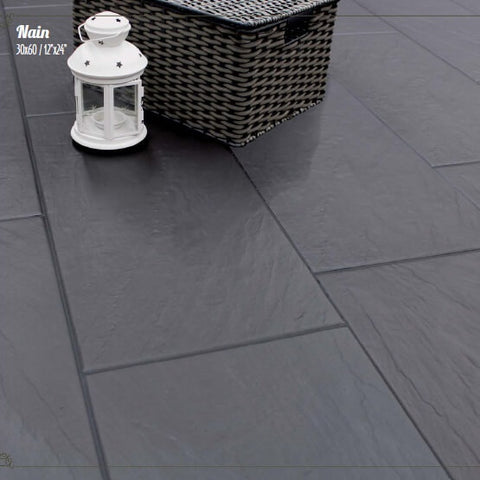 Nain Black Slate Effect Tiles on a Patio with Wicker Basket