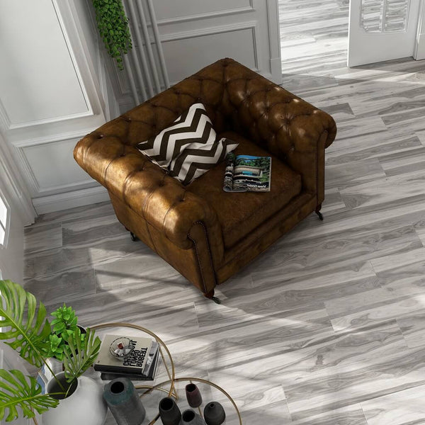 Woodland Grey Wood Effect Floor Tiles in Living Room with Leather Armchair