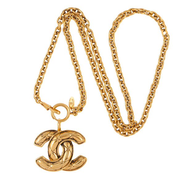1980s Vintage Chanel Gilt Metal Quilted Pendant