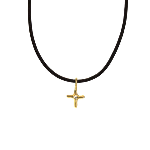 A simple everyday accessory or the perfect layering necklace, this Gold & Diamond Cross Necklace is a must-have. It features a small, organic yellow gold cross with a diamond inlaid in the center and dangling from brown leather. Each piece is handcrafted and made to order at Rebecca Lankford Designs in Houston, Texas.