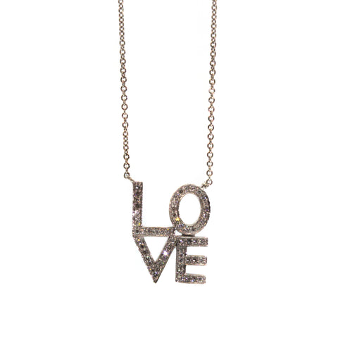 "This Diamond Love Letter Necklace was handcrafted at Studio 703 + RLD in Houston, Texas. It features the letters ""L"" and ""O"" stacked on top of a ""V"" and ""E"" in 14k white gold and pave set with shimmering diamonds over each letter."