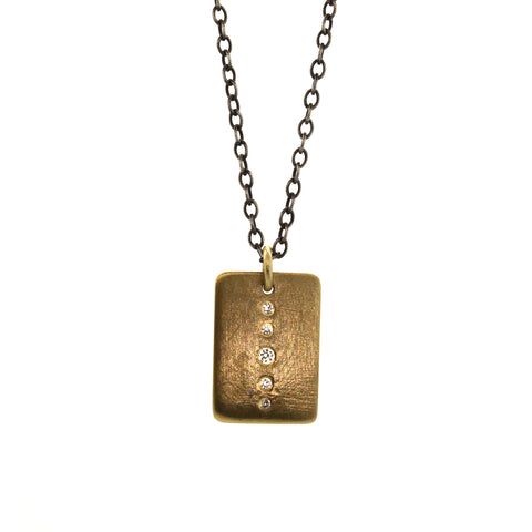 This Large Diamond Brick necklace features a rectangular gold pendant with 5 diamonds inlaid in a graduating pattern dangling from a long oxidized silver chain. It was hand crafted by one of Houston's finest custom jewelers, Rebecca Lankford, in Houston Heights.