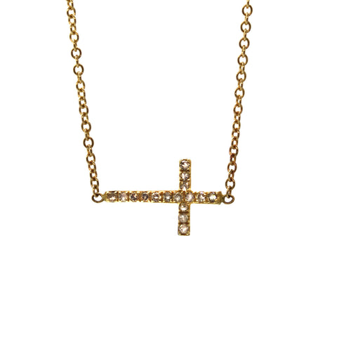 This Everyday Diamond Cross Necklace is just that! Consisting of a yellow gold cross pave set with shimmering champagne diamonds and soldered sideways into the chain, this necklace is simple, versatile, and full of sparkle! It was handcrafted at Rebecca Lankford Designs in Houston, Texas.